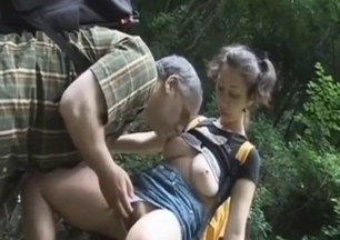 Dad licks his daughter's shaved pussy in the forest