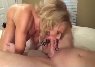 Blonde mom performs a head for her son