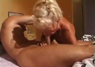 Blaeached MILF gives a good blowjob for a younger brother