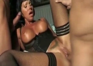 Dark-haired mom is blowing two hard dongs