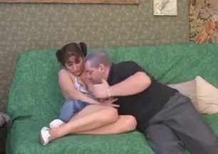 Dad stimulates his slutty daughter on the sofa